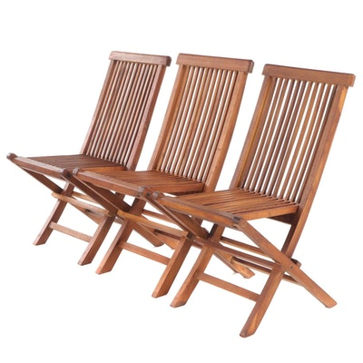 Three Slatted Walnut Folding Chairs