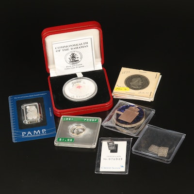 Eleven Silver Coins and Ingots