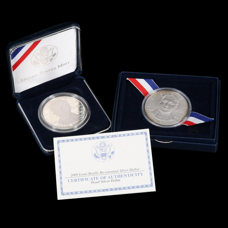 Two 2009 Louis Braille Commemorative Silver Dollars