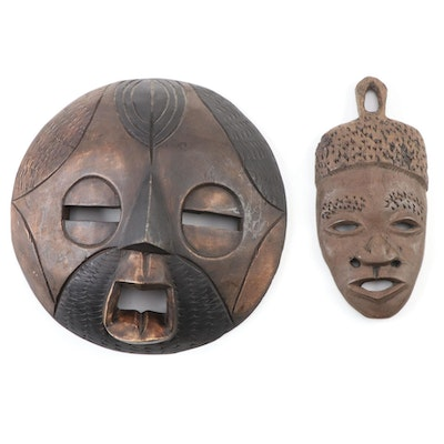 Ghanaian Carved Wood Mask and Haitian Style Wood Mask