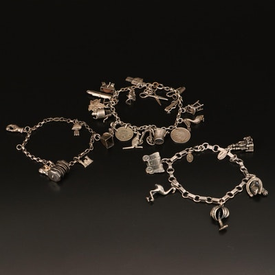 Vintage Sterling Charm Bracelets Including Coins, Articulated and Disney Charms