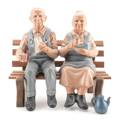 Hershey  Seated Couple Figurines on Wooden Bench
