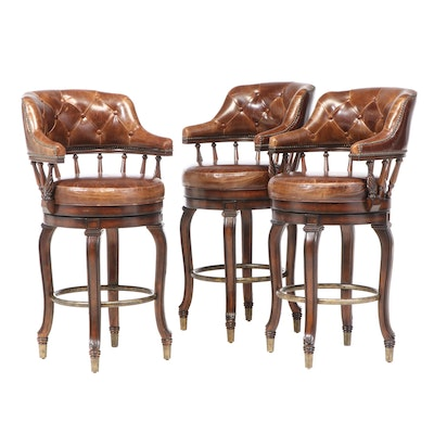 Three Frontgate Hardwood, Patinated Metal, and Brown Leather Swivel Bar Stools