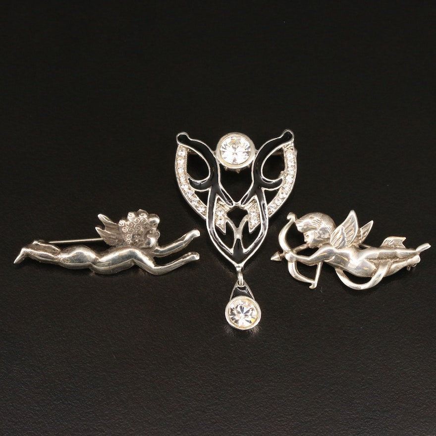 Sterling Silver Cubic Zirconia and Enamel Brooches Featuring Cherubs