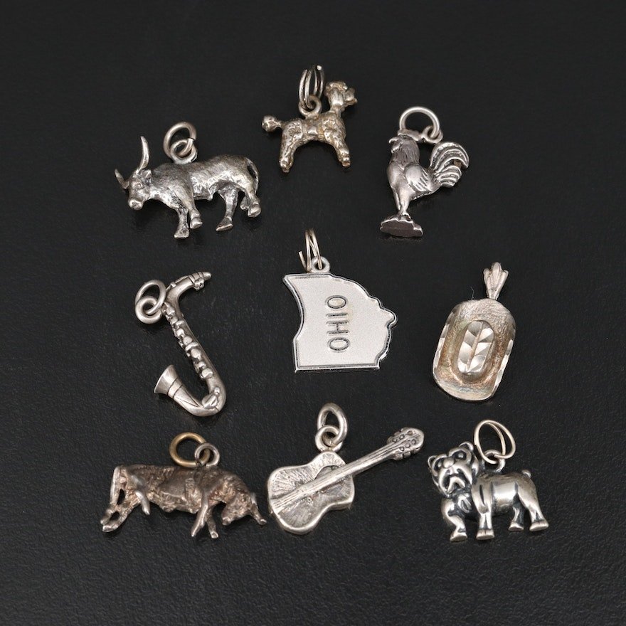 Sterling Charms Including Guitar and Bull Charms