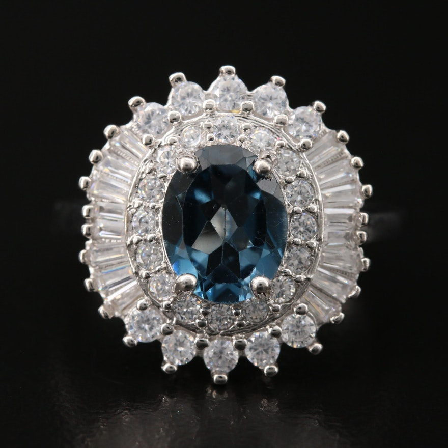 Sterling London Blue Topaz Ring Surrounded by Cubic Zirconia