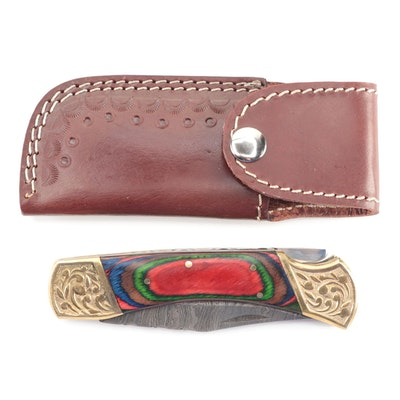 Damascus Steel Folding Knife with Swirl Colored Handle and Leather Sheath