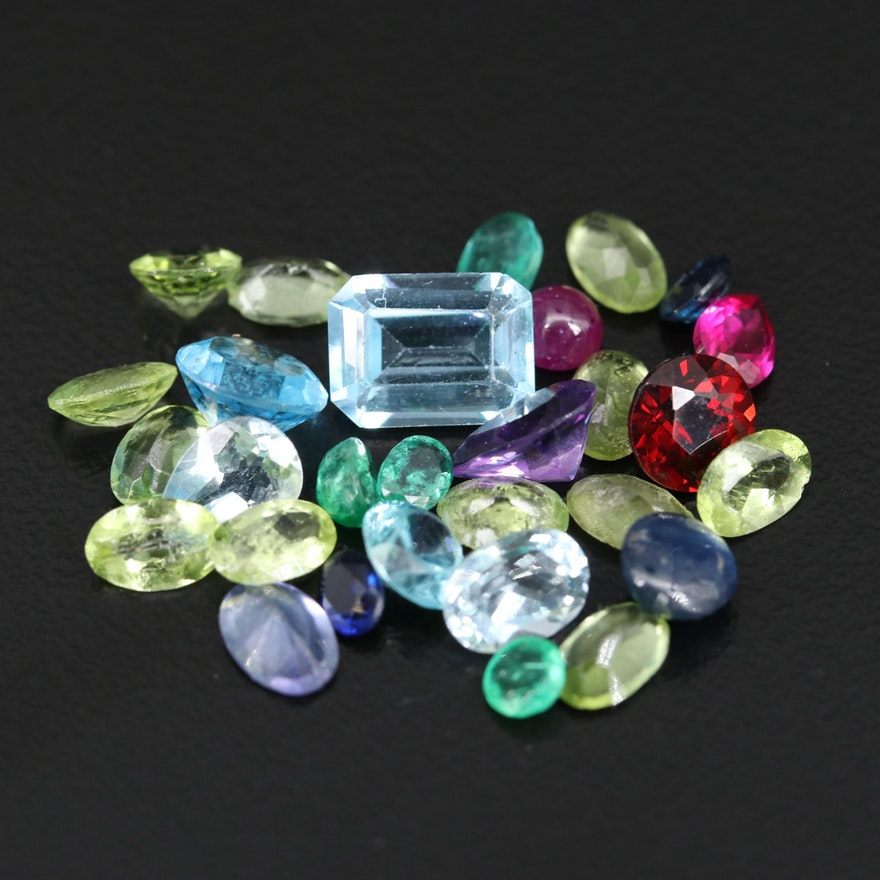 Loose 17.42 CTW Gemstones Including Ruby, Sapphire and Emerald