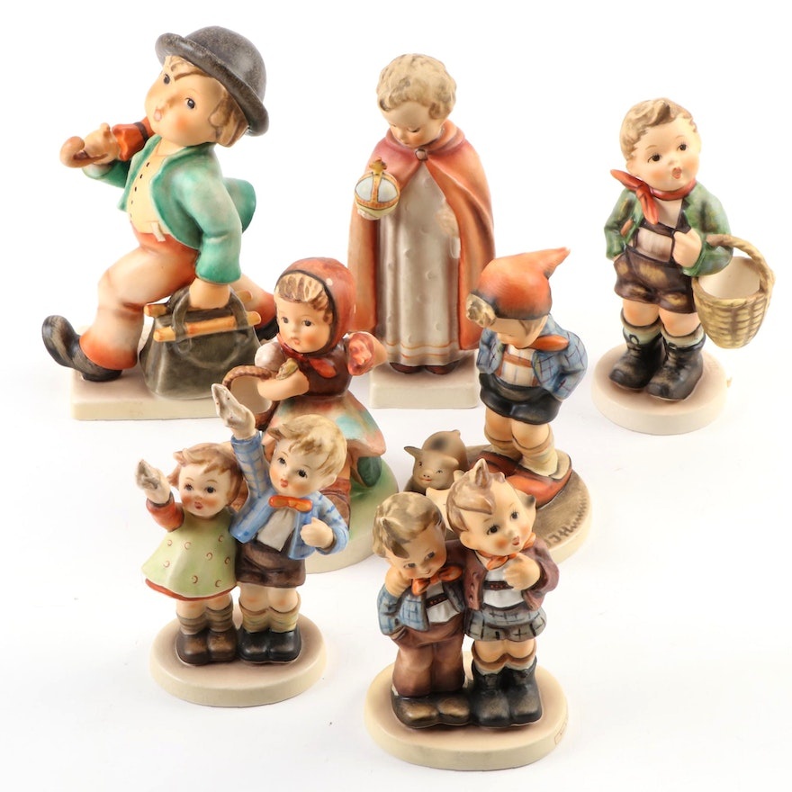 "Goebel ""Merry Wanderer"" with Other Porcelain Hummel Figurines"