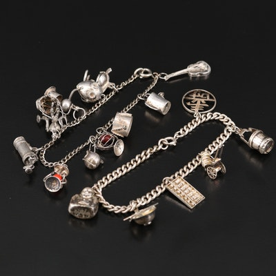 Sterling Charm Bracelets Including Gas Mask and Laughing Buddha Charms