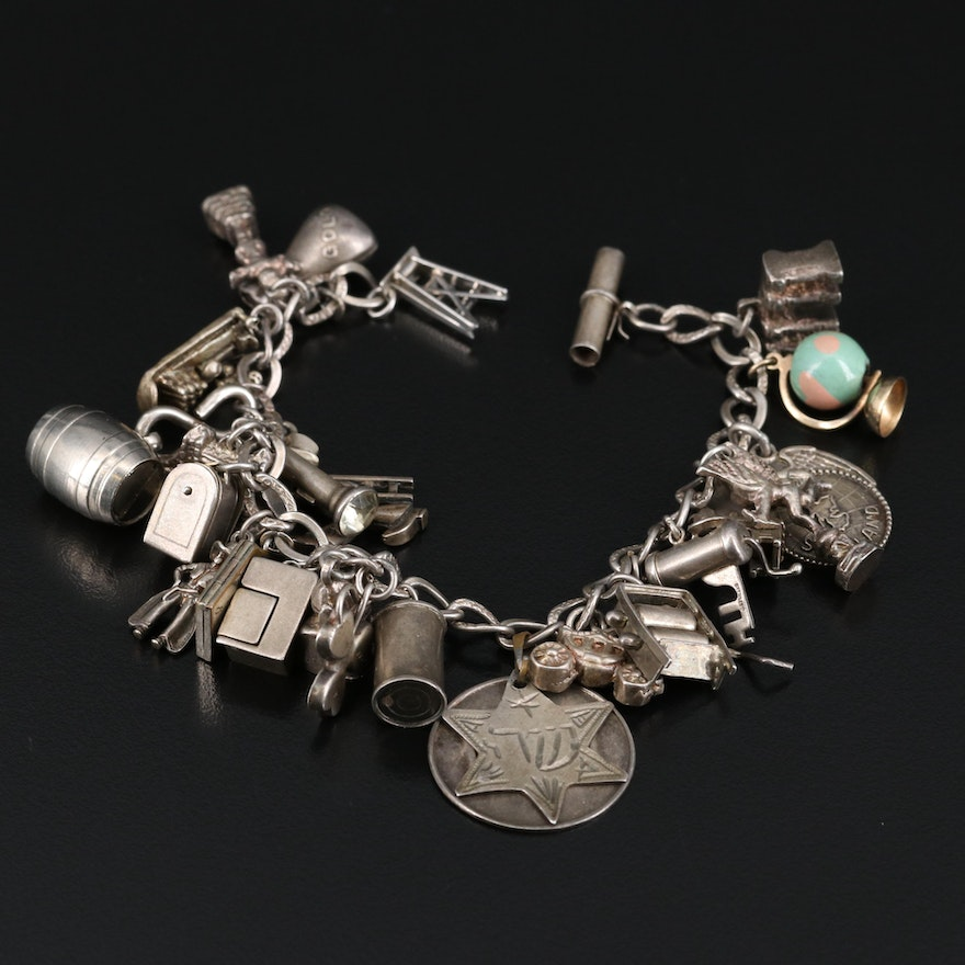 Sterling Charm Bracelet with 10K Globe and Carriage Charms