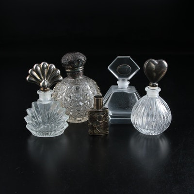 English Sterling Topped Perfume Bottle with Other Silver Embellished Bottles