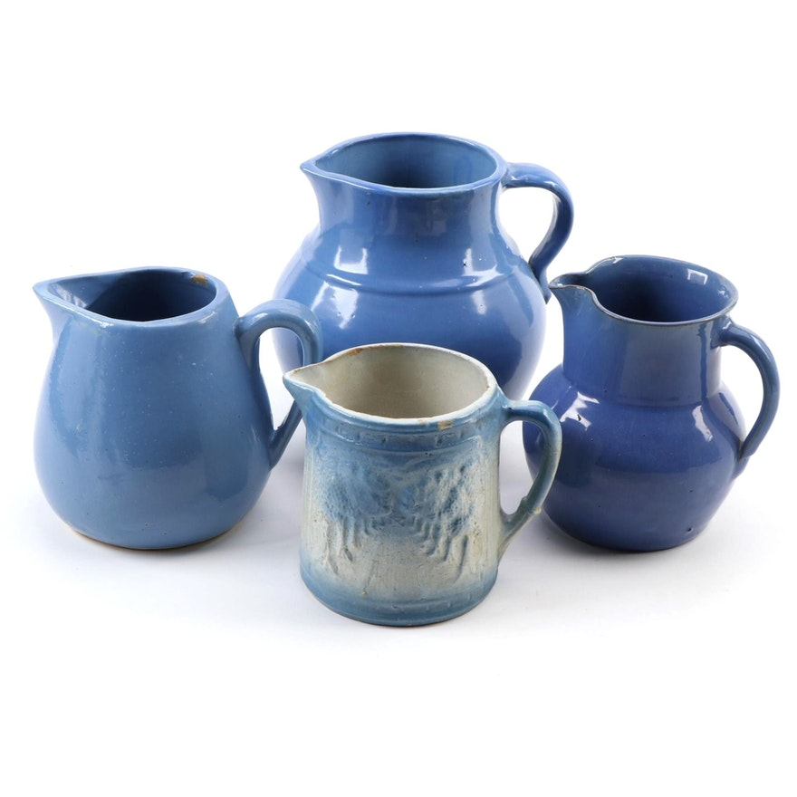 Slat Glazed Cottage Path Through Trees and Other Blue Ceramic Pitchers