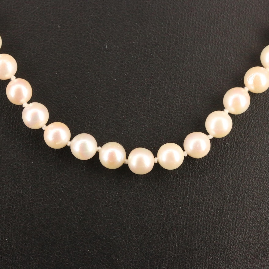 Knotted Strand of Pearls with 14K Clasp