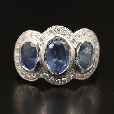 Platinum Three Stone Sapphire Ring with Diamond Halos