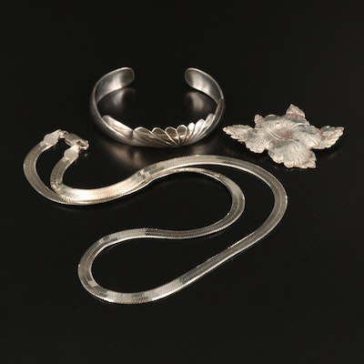 Sterling Jewelry Including Herringbone Chain Necklace and Hibiscus Brooch