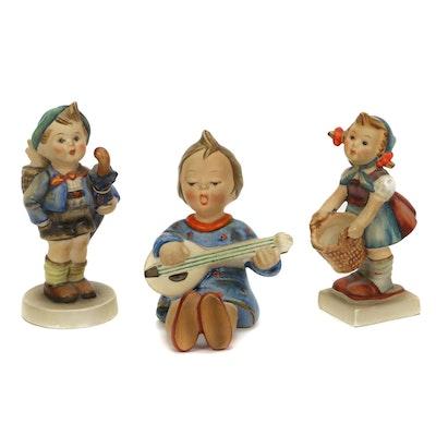 """Goebel Hummel Porcelain Figurines Including """"Home from Market"""" and """"Joyful"""""""