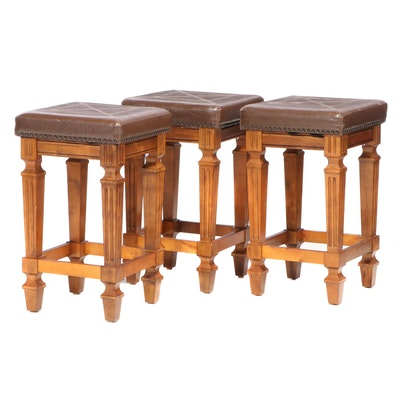 Three Contemporary Hardwood and Faux-Leather Bar Stools