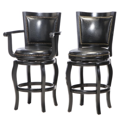 Two Black Finish Swivel Barstools with Bonded Leather Upholstery