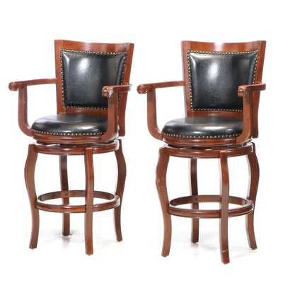 Two Contemporary Walnut Finish Swivel Barstools with Bonded Leather Upholstery