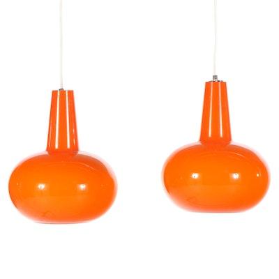Pair of Holmegaard Danish Modern Orange Coated Milk Glass Pendant Lights