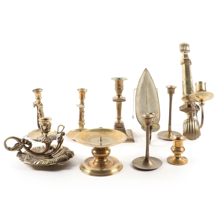 Pivoting Ship's Chamberstick and Other Brass Candlesticks and Wall Sconces,