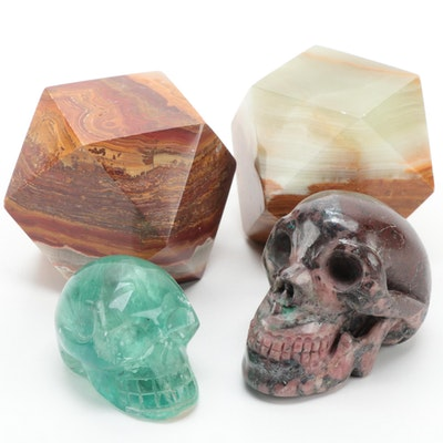 Polished Carved Stone Paperweights Including Rhodonite and Green Fluorite Skulls