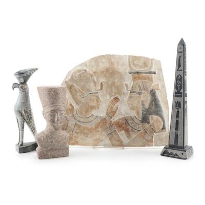 Bust of Nefertiti, Obelisk, Horus Figurine, and Plaster Relief of Ramses II