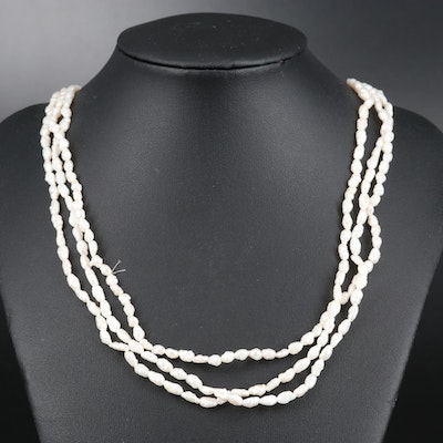 Triple-Strand Semi-Baroque Pearl Necklace with 14K Clasp