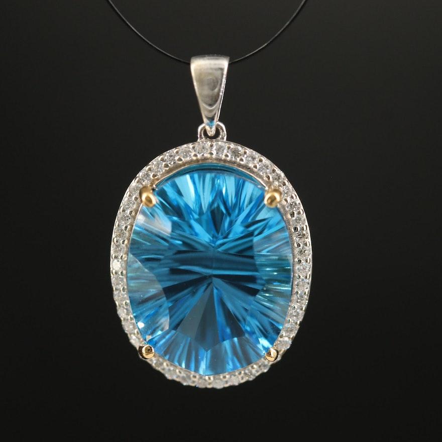 14K Swiss Blue Topaz and Diamond Halo Pendant