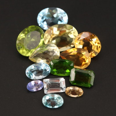 Loose 16.10 CTW Mixed Gemstones Including Diopside and Topaz