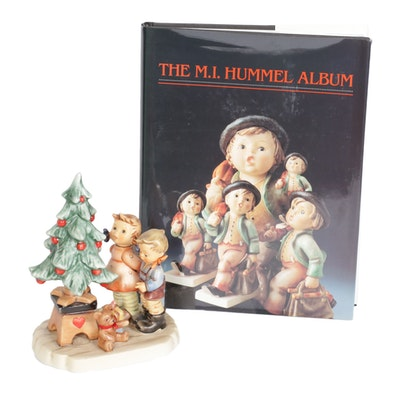 "Goebel ""Wonder of Christmas"" Figurine with the M.I. Hummel Album"