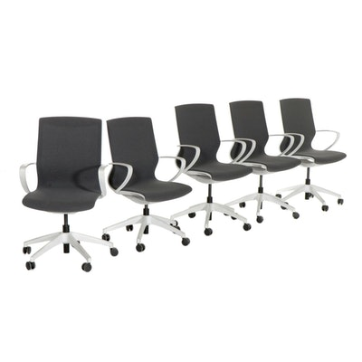 Five Molded Plastic Upholstered Office Chairs, 2010