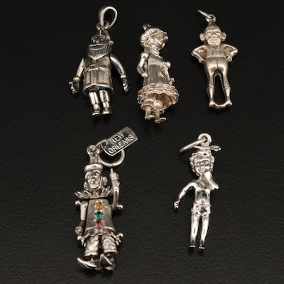 Figural Charms Including Santa Claus, Clown and Child Charms and Sterling