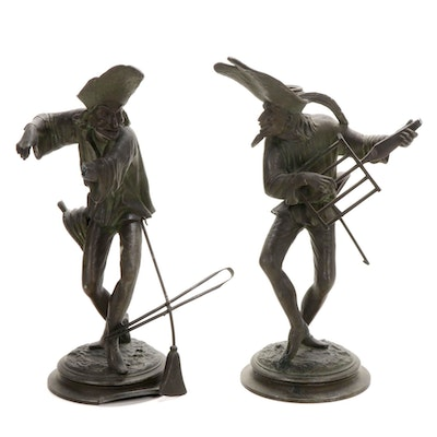 Fire-Tending Figural Metal Candlesticks