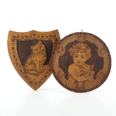 Flemish Art Co. Pyrographic Wall Plaques of a Cat, and a Child Holding a Kitten