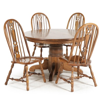 Oak Pedestal Dining Table and Four Windsor Style Chairs, Late 20th Century