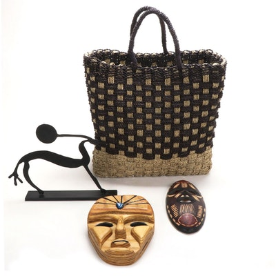 Carved Wood Tribal Masks, Metal Sculpture, and Woven Jute Bag