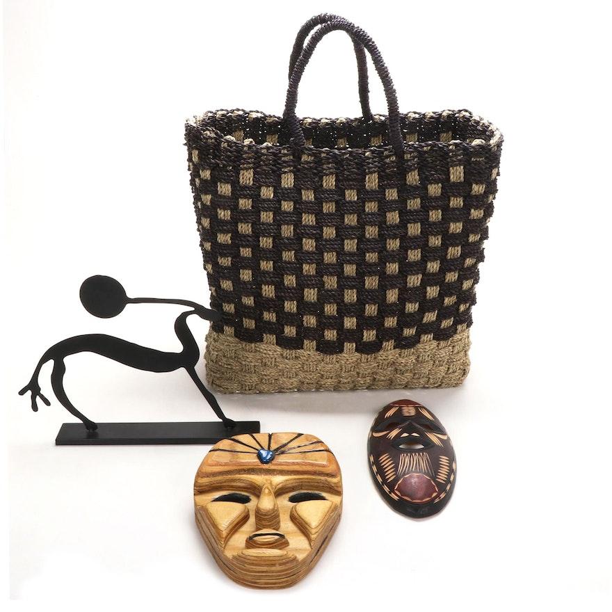Carved Wood Tribal Masks, Metal Sculpture, and Woven Jute Bag