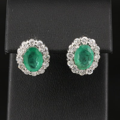 Platinum 3.60 CTW Emerald and 1.20 CTW Diamond Halo Earrings