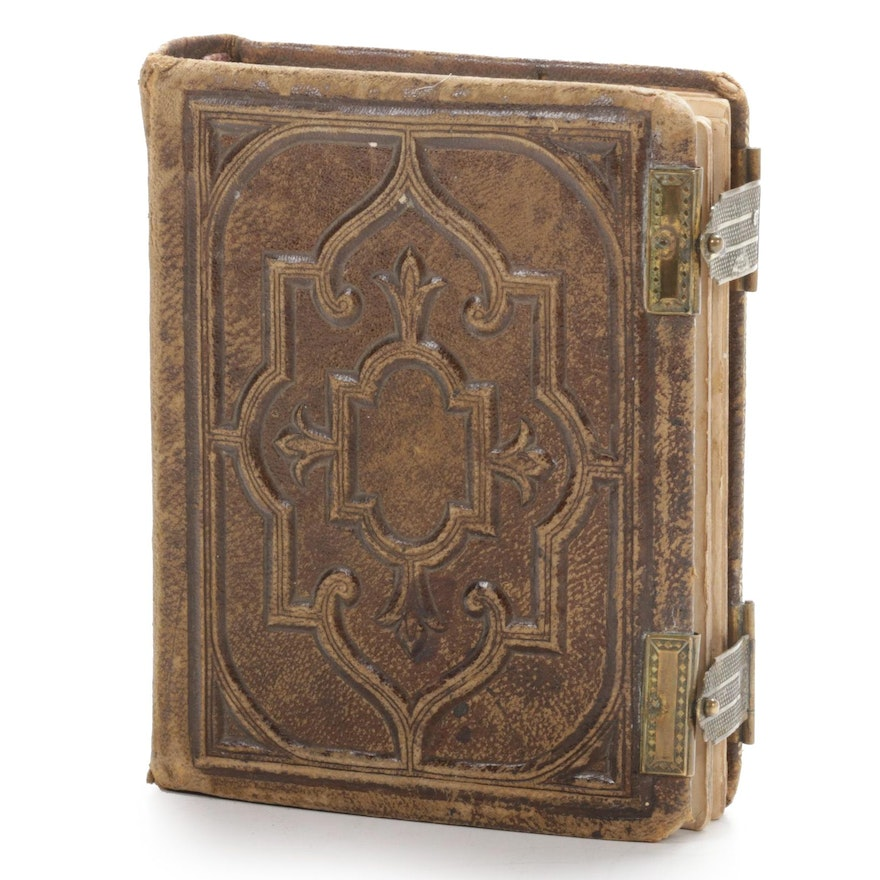 Tintype and Other Portraits in Embossed Leather Album, 1891