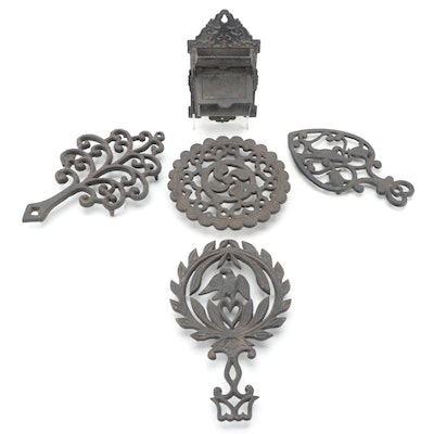 Virginia Metalcrafters with Other Cast Iron Trivets and Matchstick Holder