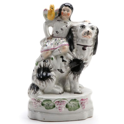 Staffordshire Ceramic Figurine of Child with a Dog and Bird, Late 20th Century