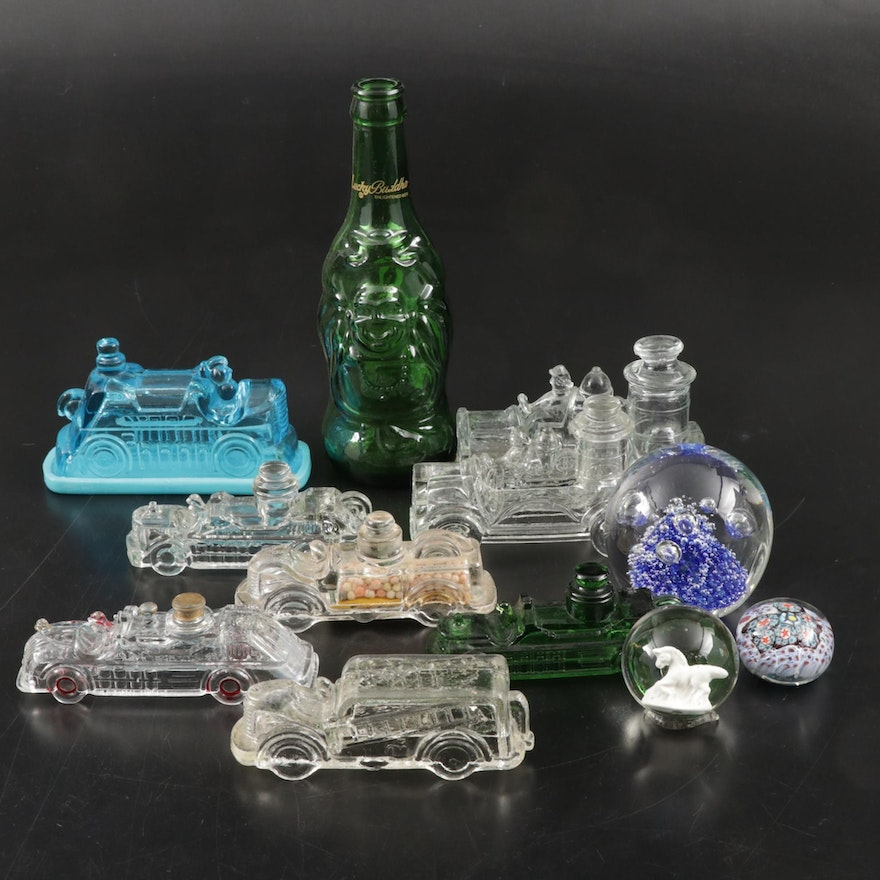 Glass Paperweights with Figural Glass Trains and Others