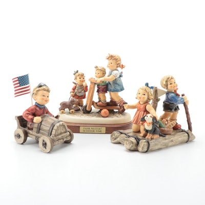 "Goebel Hummel Porcelain Figurines Including ""American Spirit"" and ""Scooter Time"""