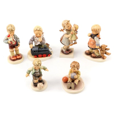 "Goebel Hummel Porcelain Figurines Including ""Nutcracker Sweet"" and ""Kiss Me"""
