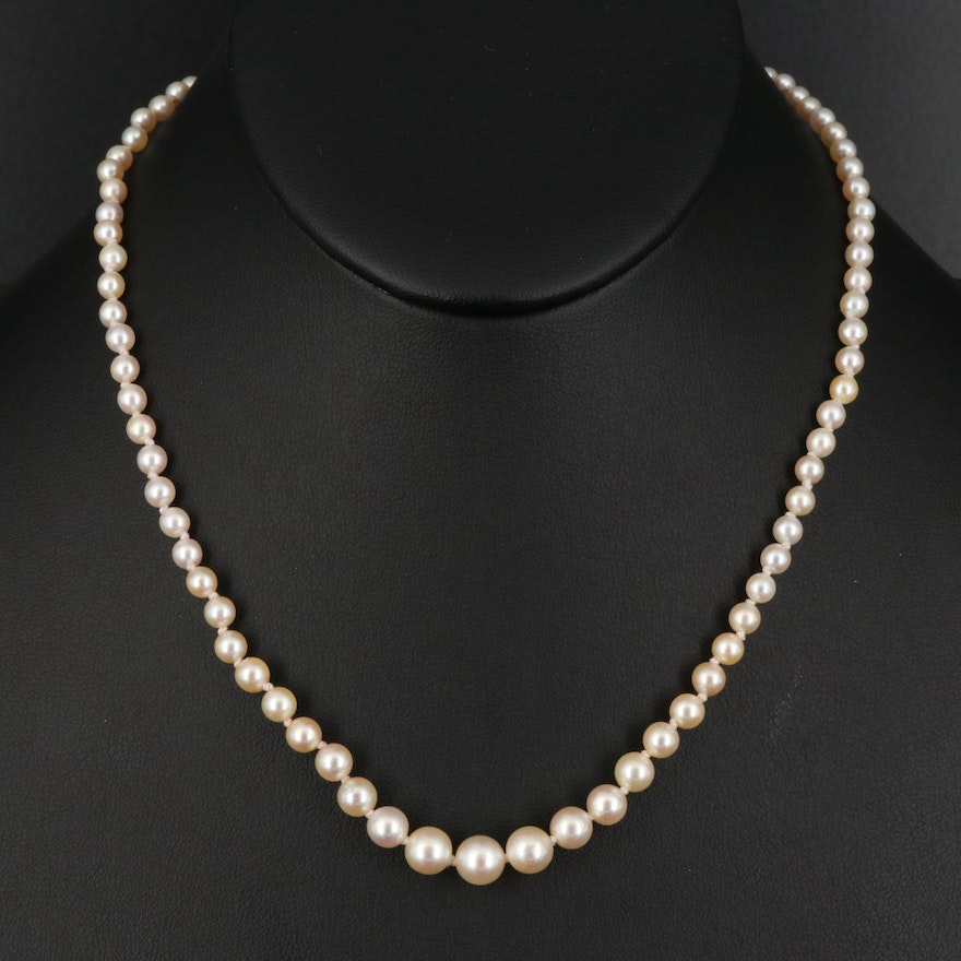 Graduated Strand of Pearls with Vintage 18K and Platinum Diamond Clasp