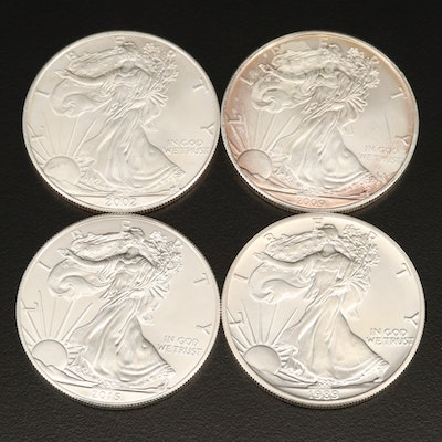 Four $1 American Silver Eagle Coins