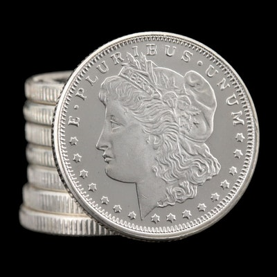 Eight Morgan Dollar Themed 1/4th Troy Ounce Silver Rounds