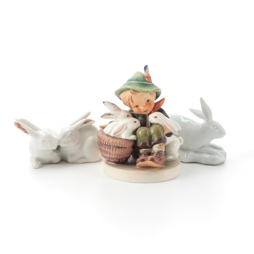 "Goebel ""Playmates"" Hummel Figurine with Other Porcelain Rabbit Figurines"
